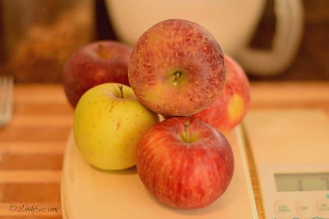 weighing fresh apples for preparing fresh apple chunk olive oil cake