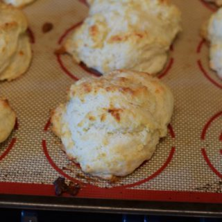 A baking sheet with cooked Tender Simple Homemade Buttermilk Drop Biscuits.