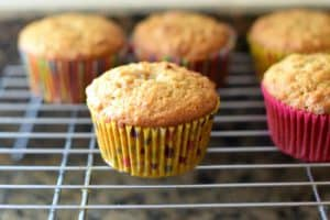 A rack OD Papaya Pecan Coconut Muffins.