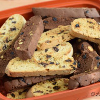 Chocolate Cherry with Pistachio Biscotti in a air tight orange container.