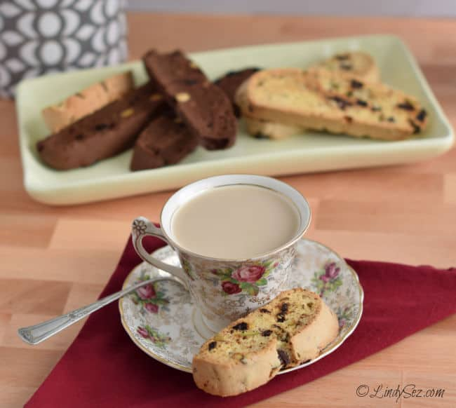 Ready to dip in a cup off coffee, chocolate cherry biscotti in the background.