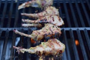 The Slanted Doors Lemongrass Grilled Lamb Chops on the grill getting a nice char.