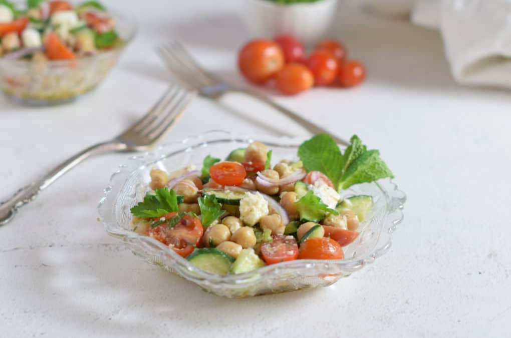 A glass dish of Mediterranean Chickpea Salad with Feta Cheese/