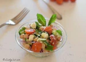 Mediterranean Chickpea - Garbanzo Bean Salad with Feta in a crystal bowl.