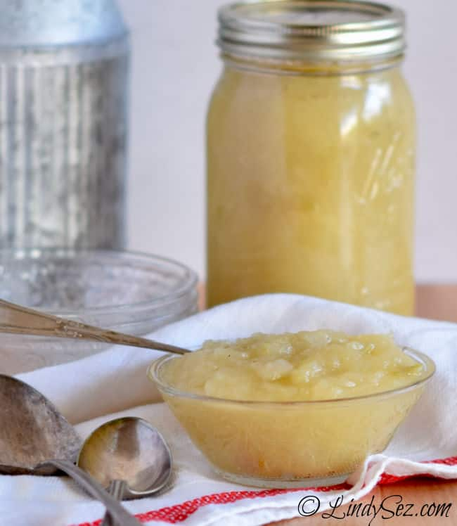 A mason jar filled with delicious homemade sweet tart applesauce.